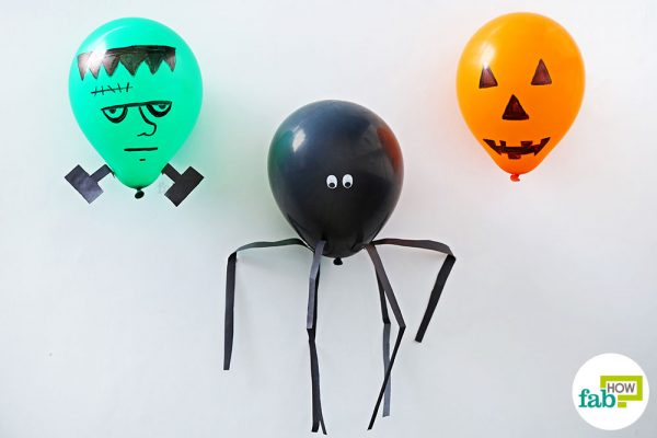 Use DIY Halloween decorations made using ballons to decorate your home