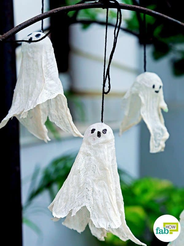 Hang up DIY cheesecloth hanging ghosts outside your house this Halloween