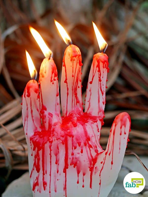 Light up your DIY creepy hand candle this Halloween