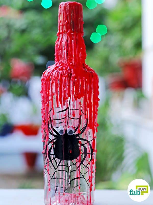 Make your own DIY Halloween decoration with an empty wine bottle