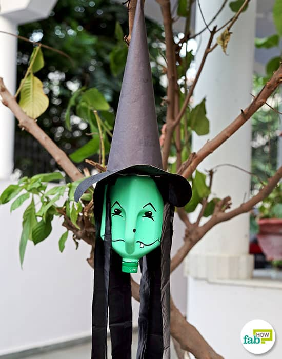 Use DIY milk jug witch to decorate your house this Halloween
