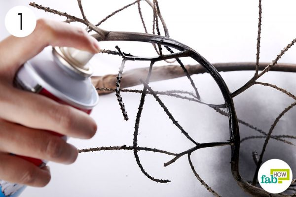 Spray paint the branch black to make DIY Halloween decoration