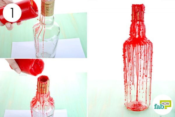 Artistically pour red wax over a wine bottle to make DIY Halloween decoration