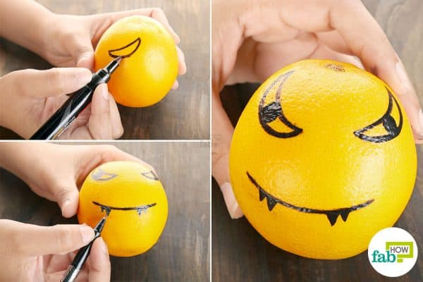 Make spooky faces on each orange to make halloween treat