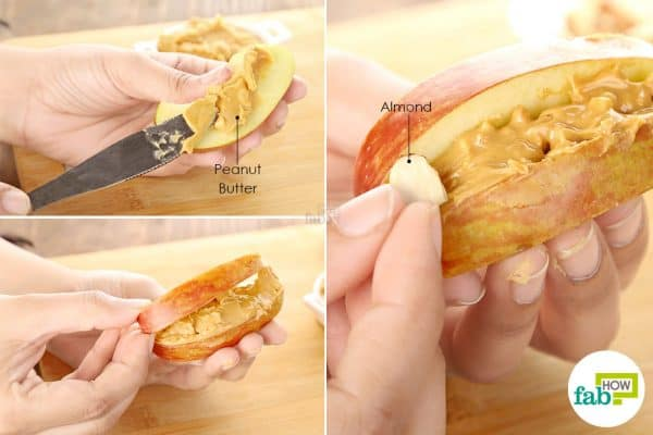 Slather peanut butter and fix almonds between apple slices to make halloween treats