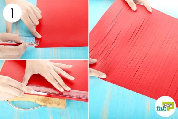 Cut vertical stripes lengthwise on the red sheet