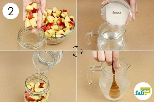 Pour sugar solution over the apples to make apple cider vinegar