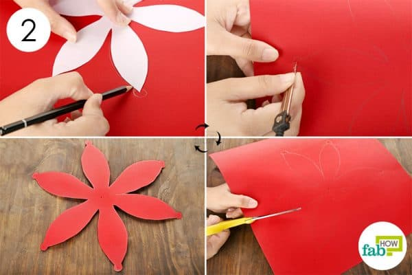 Use the stencil to trace and cut out shapes on the red sheet