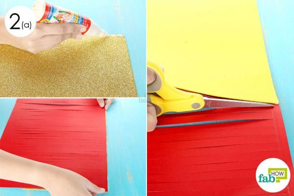 Paste the striped red sheet over the golden glitter sheet