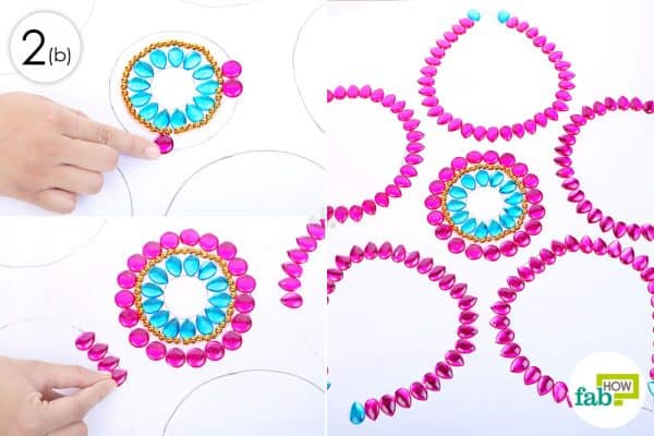 Add round pink rhinestones around the center and drop-shape rhinestones for the petals