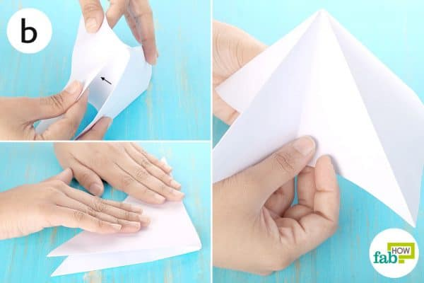Create a mountain fold by pushing in the non-creased sides