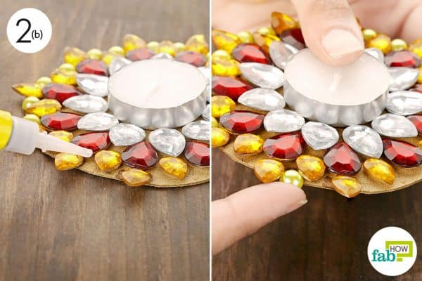 Paste glittering golden beads on the circular edge to cover up the cardboard completely