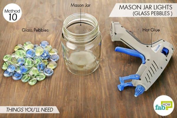 Things needed to make Mason jar lights using glass pebbles