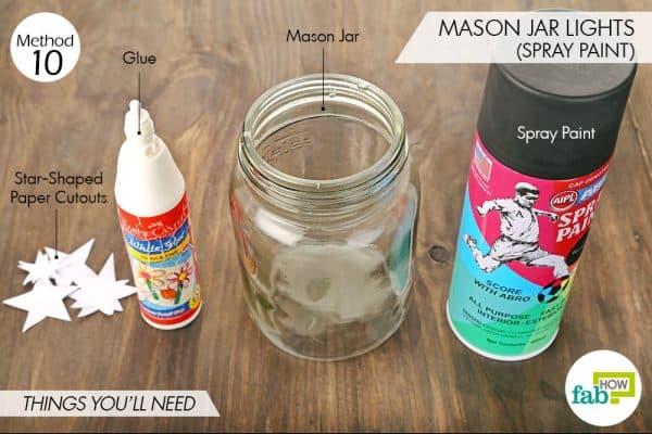 Things needed to make Mason jar lights using spray paint