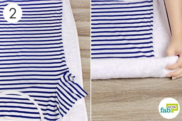 Spread the cloth on a dry towel, then roll it up