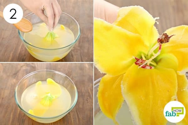 Submerge the artificial flowers in the solution in order to use borax to add crystals on artificial flowers