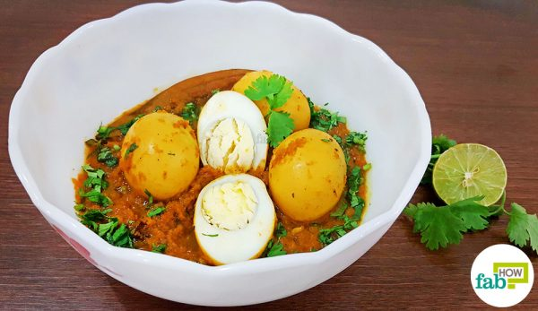 Garnish with cilantro or coriander to make North Indian egg curry