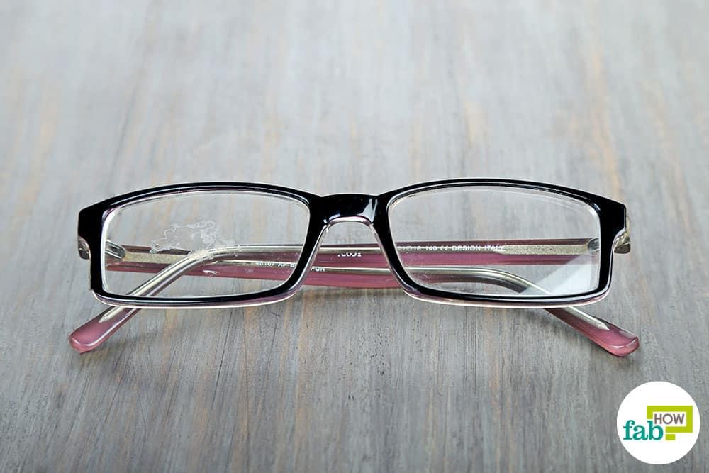 how to clean super glue off plastic lenses