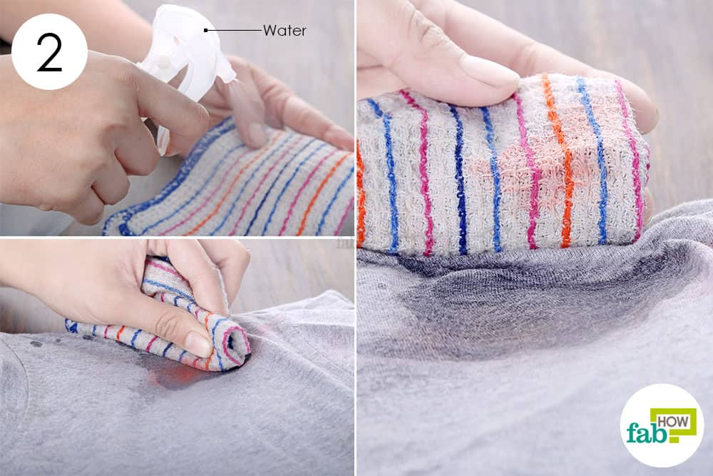 use a damp cloth to remove lipstick stains from clothes