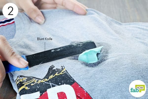 scrape off the glue to remove chewing gum from clothes