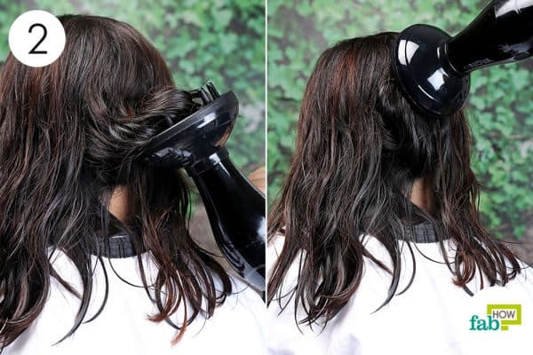 use low heat and slow air speed to blow-dry curly hair