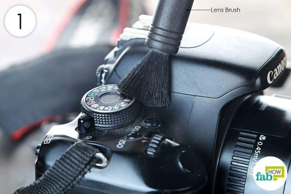 remove dust with lens brush to clean dslr the right way