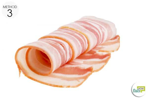 secure bacon fat on the affected area with a gauze or tape to remove the splinter