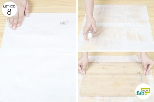 place chopping board on damp paper towel