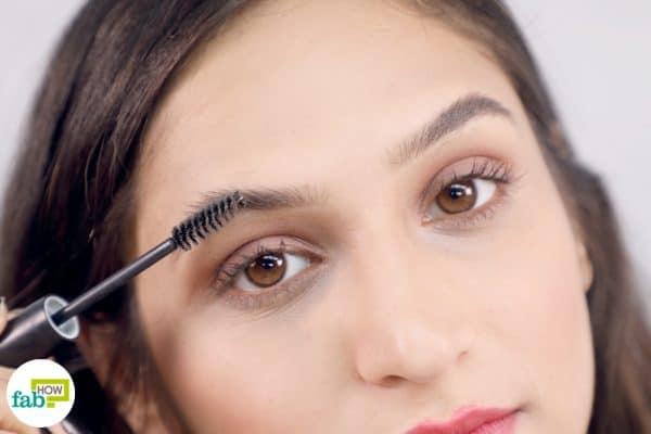 shape eyebrows with a mascara brush